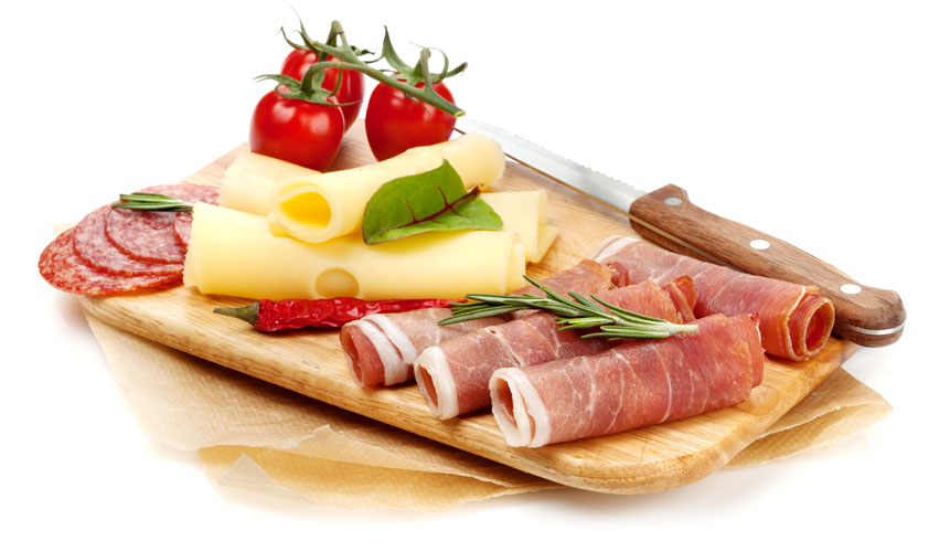 photo of meat and cheese on cutting board