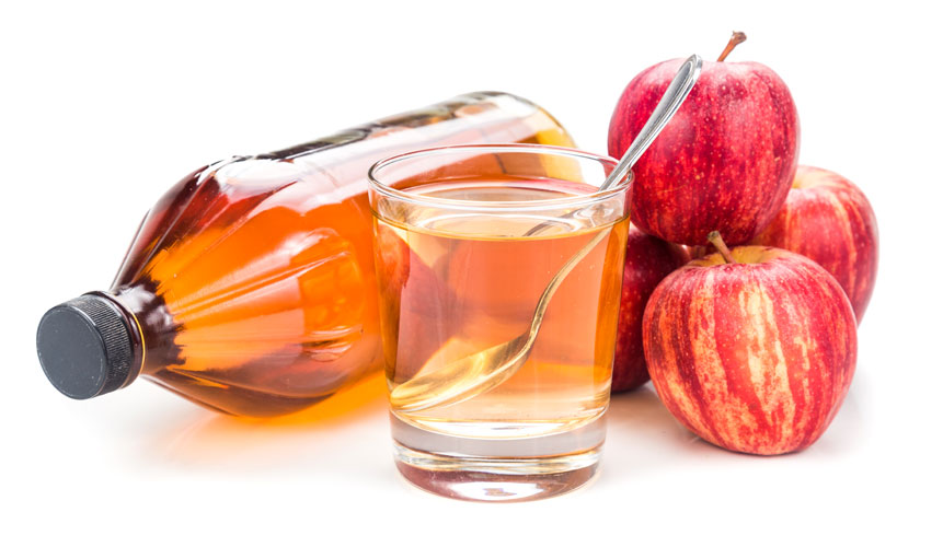 photo of apple cider vinegar with apples